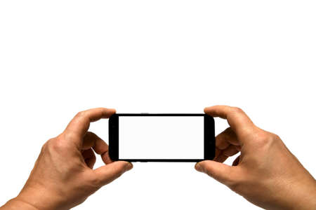 Hands holding mobile smart phone with blank screen. Isolated white background Stock Photo