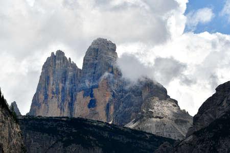 Dolomitic group of Tre Cime di Lavaredo or Drei Zinnen in Sexten Dolomites near Cortina d'Ampezzo, Italy Фото со стока