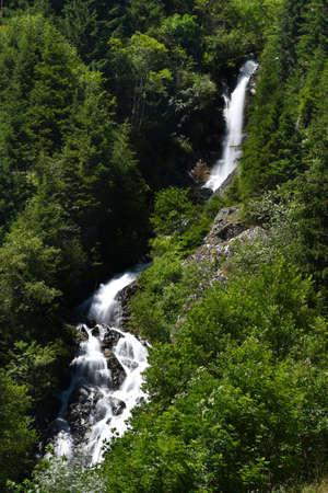 Waterfalls in the forest near Anterselva di sotto (Val Pusteria). South Tyrol, Bolzano. Italy. long exposure shot Archivio Fotografico
