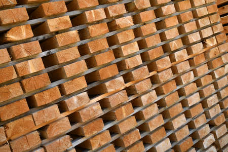 detail of worked wooden boards stacked in a sawmill near Brunico. south tyrol, italy.