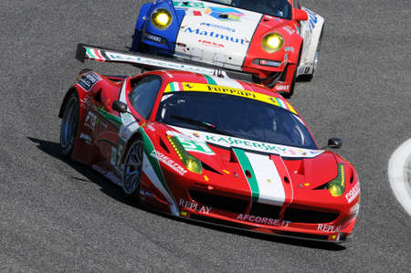 Imola, Italy 3 July 2011: Ferrari 458 Italia GTC GTE Pro of Team AF Corse driven by Fisichella and Bruni in action during Race 6H ILMC at Imola Circuit.