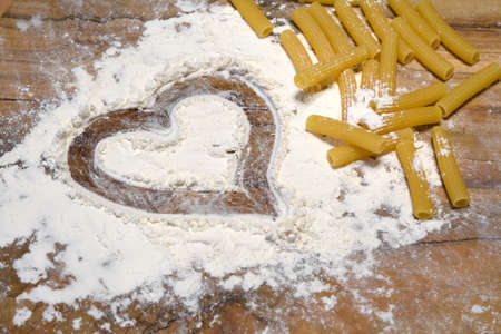 top view of heart and pasta (striped celery)
