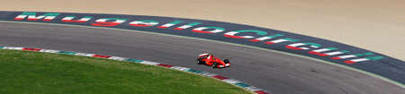 MUGELLO, IT, OCTOBER 2017: Ferrari F2001 driven by unknown in action at Mugello Circuit during the Finali Mondiali Ferrari 2017 Show with the Logo of the Circuit at San Donato curve. italy