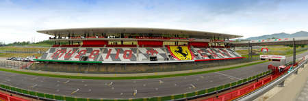 MUGELLO, ITALY - MAY 2012: view of the central tribune at Mugello Circuit during the Official F1 Test Days with the giant logo of Ferrari. italy Redactioneel
