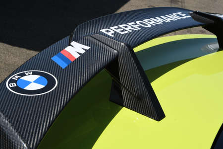 Autodromo del Mugello, IT, July 2021: Detail of Carbon fiber rear wing of the Safety Car BMW M4 Competition Coupé in the paddock of the Autodromo del Mugello, Italy.