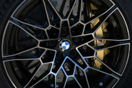 Mugello Circuit, IT, July 2021: Detail of the alloy wheels of the BMW M4 Competition Coupé Safety Car in the Paddock of the Mugello Circuit, Italy.