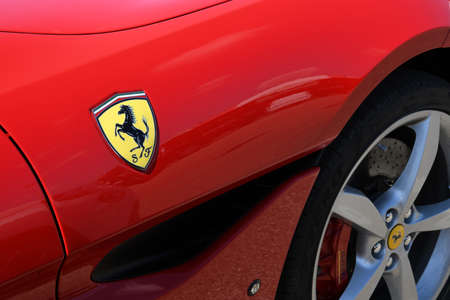 Mugello Circuit, July 2021: Detail of Ferrari Logo on the Ferrari Portofino on display in the paddock of the Mugello circuit, Italy.