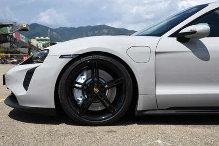 Mugello Circuit, July 2021: Detail of the alloy wheel of a Porsche Taycan Turbo S in the paddock of the Mugello Circuit, Italy.