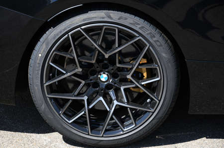 Mugello Circuit IT, July 2021: Detail of the alloy wheels of the BMW M4 Competition Coup Safety Car in the Paddock of the Mugello Circuit, Italy.