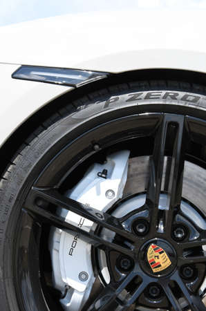 Mugello Circuit July 2021: Detail of the alloy wheel of a Porsche Taycan Turbo S in the paddock of the Mugello Circuit, Italy.