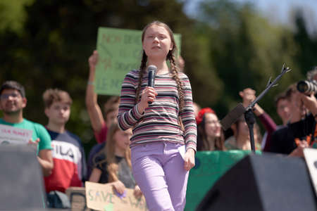 ROME, ITALY - April 19, 2019: Swedish climate activist Greta Thunberg attending Fridays For Future (School Strike for Climate) protest in front of a huge crowd near the Colosseum Editorial