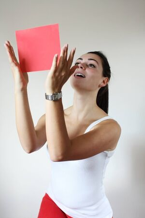 Young woman holding red paper Stock Photo - 10616026