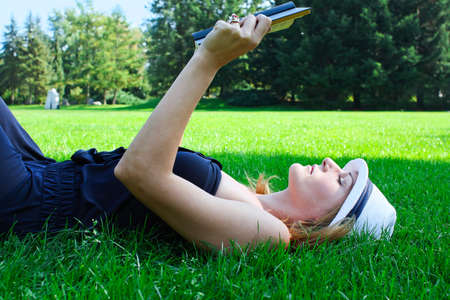Woman Smiling and lying on gras photo