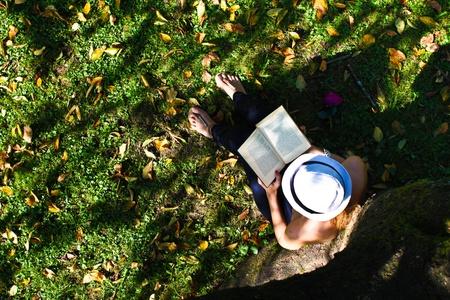 Woman reading benath tree Stock Photo - 10762565