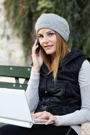 Woman on the Phone and Laptop Stock Photo - 10888925
