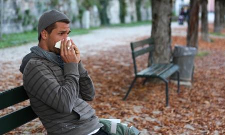 man blowing nose photo
