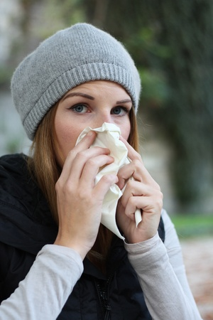 Woman blowing into tissue Stock Photo - 10888923
