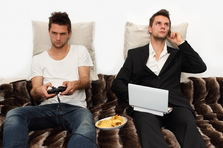 Gamer and Businessman side by side Stock Photo