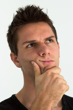 Man thinking with hand on face Stock Photo - 11107444