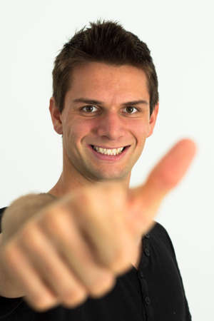 Happy smiling man doing two thumbs up Stock Photo - 11107440