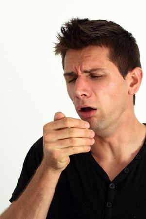 gripe: Enfermo de tos en él Foto de archivo