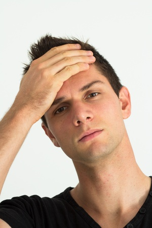 Worried young man with hand at face Stock Photo - 11107446
