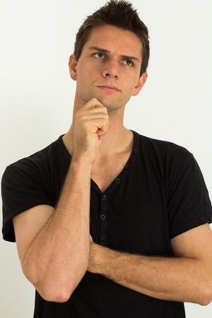 Man thinking with hand on face photo