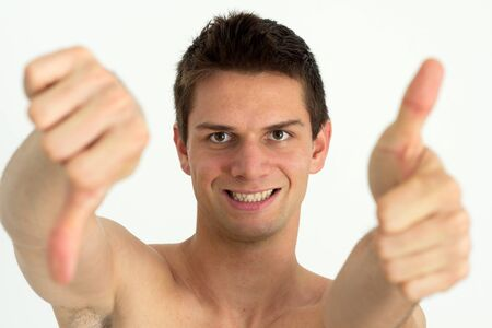 Young attrective man doing thumb up and other thumb down photo