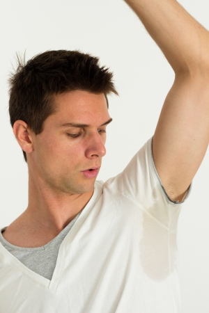 Man sweating perspire under armpit concept of a body odor photo