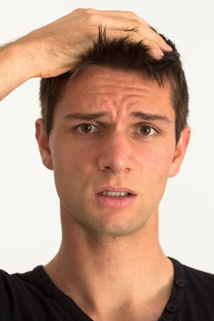 Worried young man with hand on face Stock Photo - 11261666