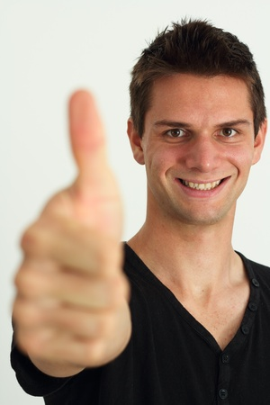 Happy smiling man doing two thumbs up photo