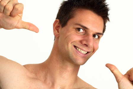 Young man smiling and pointing at himself with success Stock Photo - 11261673