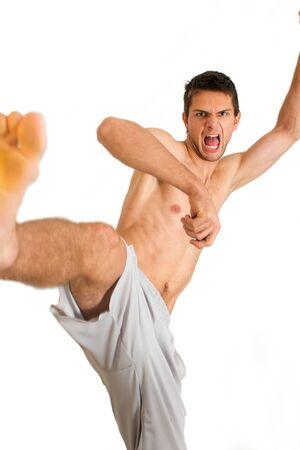 karate kick: Man doing a karate kick