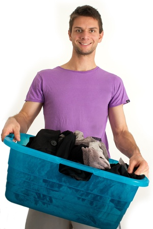 Young man doing the washing Stock Photo - 11261676