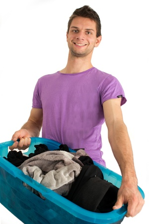dry cleaners: Young man doing the washing