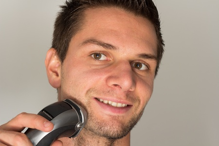 shaver: Man shaving hes beard Stock Photo