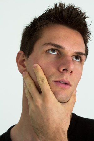 Man thinking with hand on face Stock Photo - 11261707