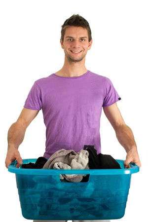 doing laundry: Young man doing the washing