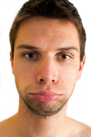 Man doing expression and blowing up lips photo