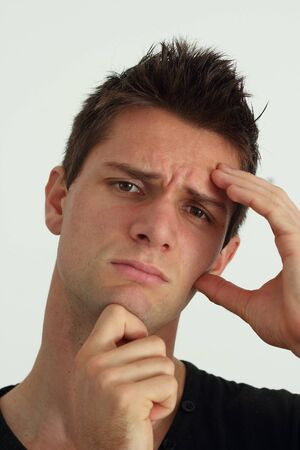 Worried young man with hand at face Stock Photo - 11261709