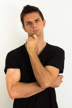 Man thinking with hand on face Stock Photo - 11261721