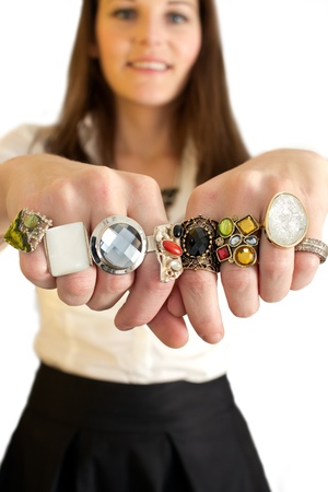 Woman showing two hands full of rings