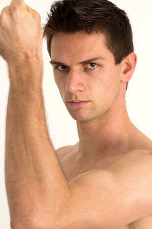 arm muscles: Man showing hes arm muscles and smiling Stock Photo