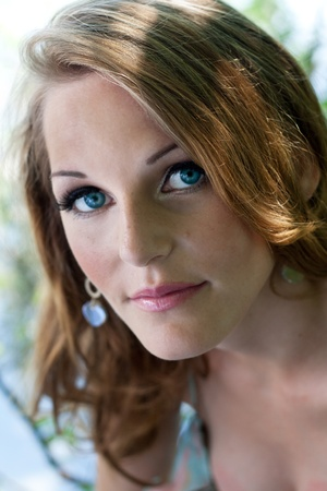 Young woman with blue eyes looking into camera Stock Photo