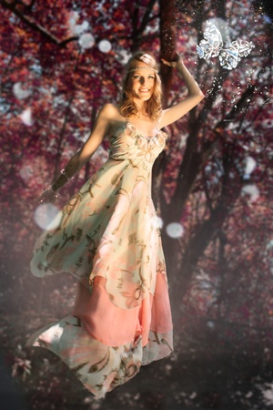 Woman in Fantasy scene with butterfly during autumnfall photo