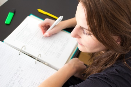 Young Woman Writing Something For The University Stock Photo - 11584170