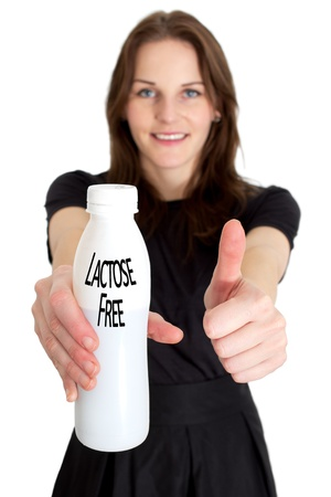 Woman Holding A Bottle Of Lactose Free Milk And Smiling And Doing A Thumb Up Stock Photo - 11584186