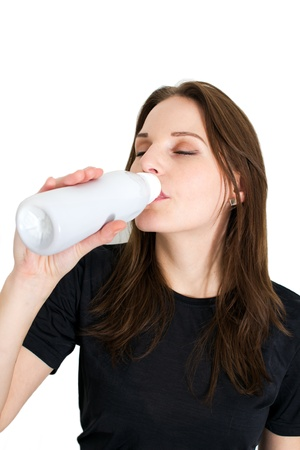 lactose intolerant: Woman Holding A Bottle Of Lactose Free Milk And Smiling And Doing A Thumb Up