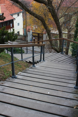 Wooden Stairs Going Downwards with a bent to the left photo