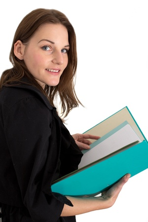 Young Female Student With A FolderBinder Reading from  it photo